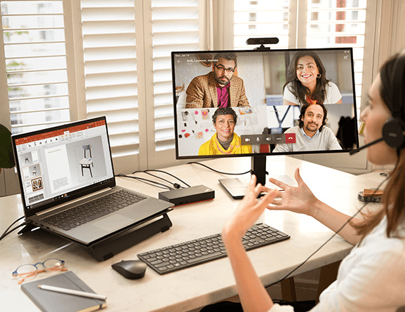 Woman using Lenovo ThinkBook 15 Gen 2 to present powerpoint for virtual meeting