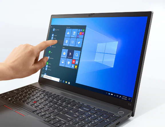 Left three-quarter view of black Lenovo ThinkPad E15 Gen 2 laptop with persons hand touching the laptops touchscreen display