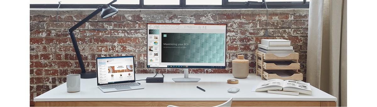 Surface Laptop Go conectat prin Surface Dock 2 la un monitor extern